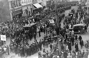 A crowd gathered in downtown Corvallis in celebration of Oregon Agricultural College's football victory over Michigan Agricultural College. The final score was 20-0. 1915.